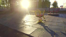 Empty children's playground. Autumn city landscape. Slow motion steadicam footag Footage