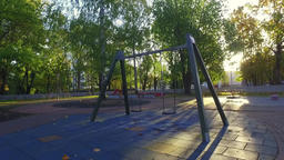 Empty playground swings. Camera around. Slow motion Footage
