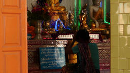 Woman praying in Buddhist temple - Popa hill, Myanmar and inside temple in Neung Live Action