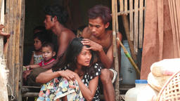 Poor adult people and children in hut near Yangon of Myanmar 2 videos sequence Footage
