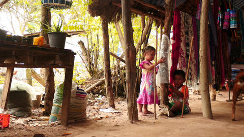 Small girl and boy in Karen village near Pattaya Thailand Footage