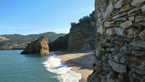 Virgin Mediterranean Beach Steady Cam Flying Over the Cliff Rocks Filmmaterial