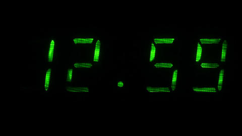 Digital clock shows the time of 12 hours 59 minutes to 13 hours 00 minutes Footage