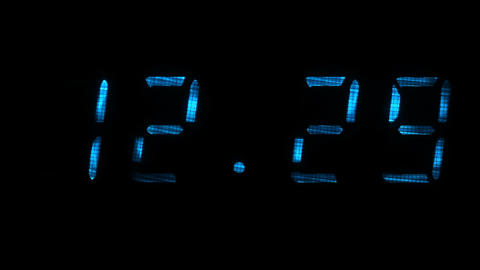 Digital clock shows the time of 12 hours 29 minutes to 12 hours 30 minutes Filmmaterial