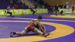 Orenburg, Russia – March 16, 2017 year: Boys compete in freestyle wrestling Live Action