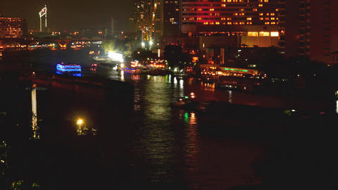 Bangkok Skyscrapers and Chao Phraya river colored vessels motion night time laps ビデオ