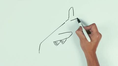Man hand draw falling plane using black marker pen on whiteboard and wipe it Footage