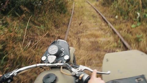 Biker in helmet ride motorcycle on forbidden railways Live Action