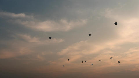 Air Balloons silhouettes in red and blue sky at a sunrise. Filmed in Bagan Of My Footage