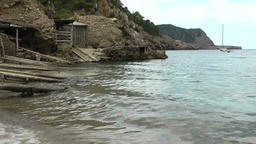 Europe Spain Balearic Ibiza coves and landscapes 015 boat hangars in cliffs Footage