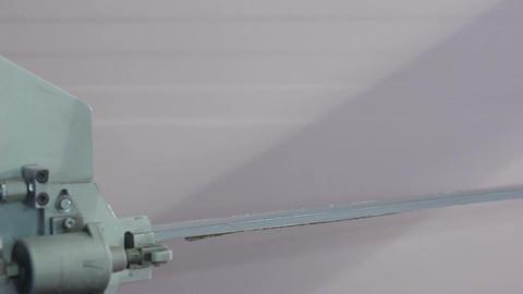 Closeup Lazer Sharp Blade Cuts Foam Rubber Block Live Action