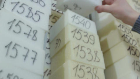 Man Puts Foam Rubber Sample with Number on High Column Footage