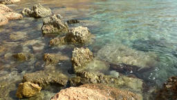 Europe Spain Balearic Ibiza coves and landscapes 050 rocks in clear water Footage
