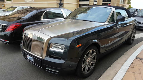 Luxury Rolls Royce Parked in Front of the Monte-Carlo Casino Footage