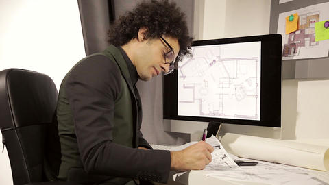Serious architect at work in office medium shot Live Action