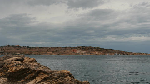 Rainy clouds at Maltese landscape and minerals rock - time lapse. filmed in Bugi Footage