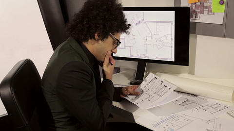 Serious architect at work in office Footage