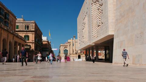 Valletta - capital of Malta - people walking at central street Footage