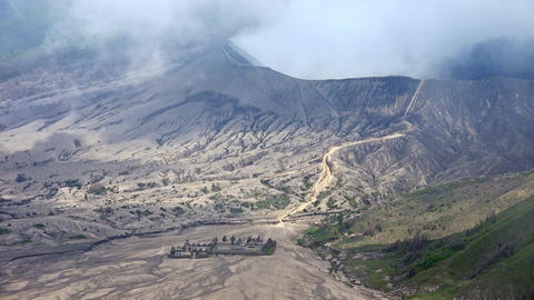 Landscape with Pura Luhur Poten hindu temple near Bromo volcano. Java, Indonesia Footage