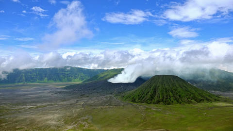 Volcanic eruption against blue sky. Mount Bromo, East Java, Indonesia Footage