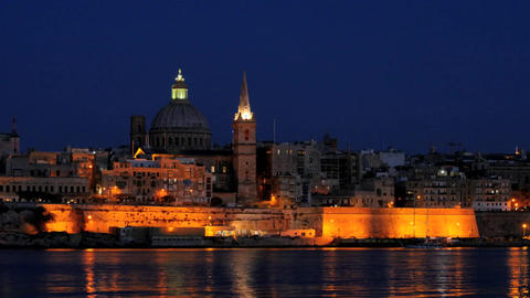 Night Valletta with Carmelite church view and floating yacht hyperlapse Footage