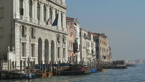 Venice, Italy Grand Canal buildings and mooring piles view Live Action