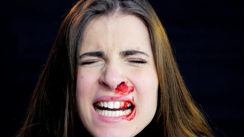 Young woman screaming after domestic violence bleeding from nose Live Action
