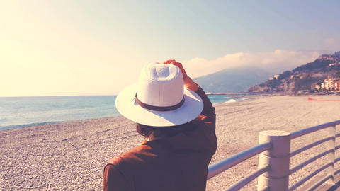Woman With Hat Looking At The Sea Footage