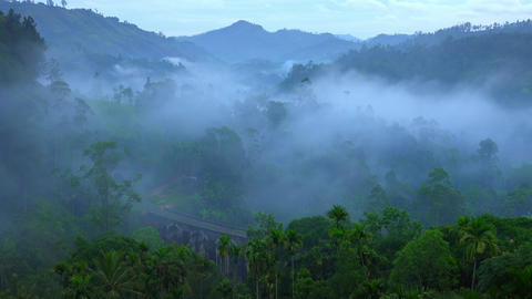 Foggy morning in mountain countryside with Nine Arches Bridge. Sri Lanka Footage