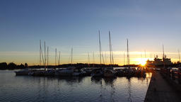 Early morning time view of yacht marina, small boats at pier, bright sunrise Footage