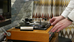 Man open cover and stop gramophone record, old-fashioned player close up view Footage
