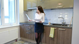 Business woman look through papers, concentrated face, stand at home kitchen ビデオ