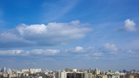 Clouds over the Rooftops of the City. Rotatable Time Lapse Footage
