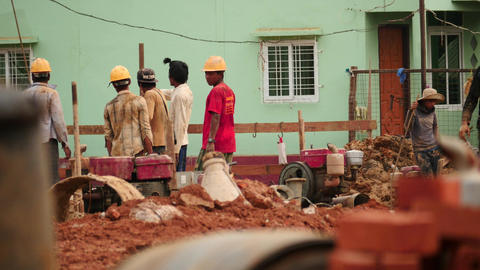 Builders at work in Yangon - Myanmar house building Footage