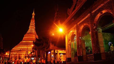 Shwedagon pagoda in Yangon of Myanmar night hyperlapse people motion Footage