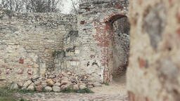 old entrance between ruined wall Footage