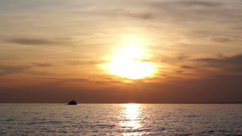 sunset at sea, mountains in background, view from moving ship Footage