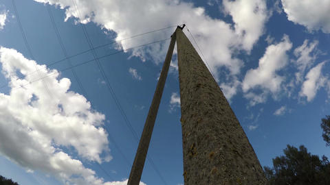 concrete electricity pole and clouds motion, time lapse 4K Footage