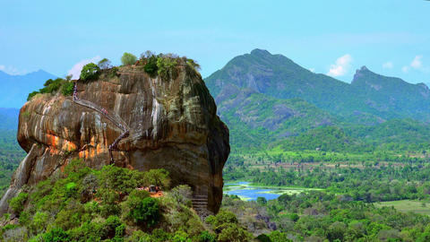 Tourists visiting famous Lion Rock fortress with ancient gardens in Sri Lanka Footage