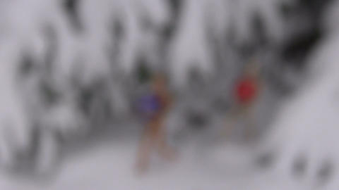 wooden manikins with Christmas bauble on snow near fir, blur focus Footage