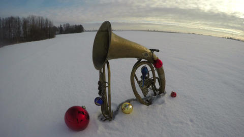 Vintage musical instruments on snow with Christmas decorations, time lapse 4 K Live Action