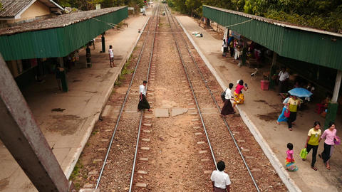 Time lapse of train arrival and departure in Myanmar station top view, Filmed in Footage