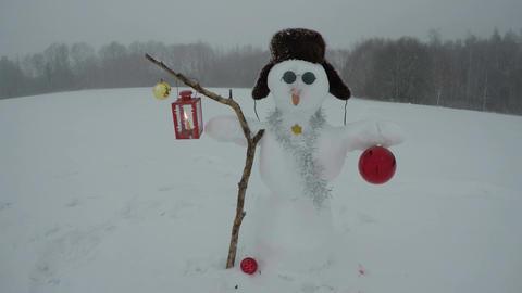 Snowman in the winter field, time lapse 4K Footage