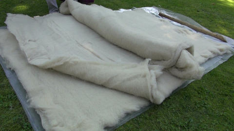 natural wool on grass in medieval summer festival Live Action