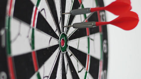 Dart Hitting The Bullseye On White Background Slow Motion Footage