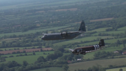 C-47 Dakota skytrain and C-130 Hercules Normandy Formation Stock Video Footage