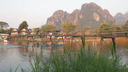 Bamboo bridge with boat and motorcycle passing,Vang Vieng,Laos Footage