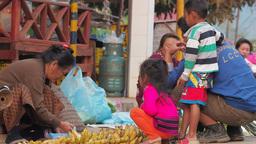 A Lady sells bananas morning market,Vang Vieng,Laos Footage