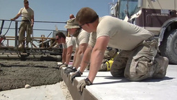 Pouring concrete to repair runway Stock Video Footage