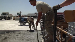 Pouring concrete to repair runway Footage
